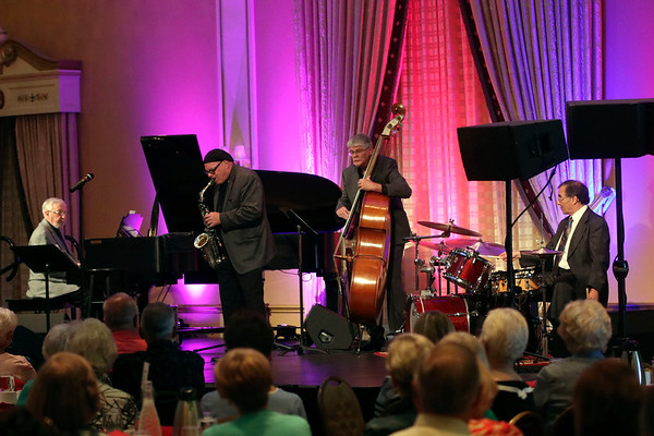 GEOFF LESAR | THE GOSHEN NEWS<br /> <br /> Saxophonist Mike Smith leads the Jim Catalano Trio in performance during the 2018 Elkhart Jazz Festival preview party Monday afternoon in the Crystal Ballroom at The Lerner Theatre in Elkhart.