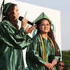 SHEILA SELMAN | THE GOSHEN NEWS<br /> Hannah Shank and Bethany Willett sing a duet during Concord High School graduation Thursday night at Jake Field.