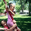 SHEILA SELMAN | THE GOSHEN NEWS<br /> Hazel Looney, 8, Goshen, right, and Cailin Clark, 10, Syracuse, swing on some playground equipment at Sunnyside Park in New Paris Monday afternoon.