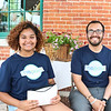 "LEANDRA BEABOUT | THE GOSHEN NEWS<br /> Nevaeh Hairopoulos and Emmanuel 'E-man' Monge, executive director of The Post youth center, collected money for admissions at the annual ""Summer Night at the Powehouse"" market."