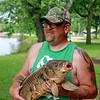 AIMEE AMBROSE | THE GOSHEN NEWS<br /> <br /> Kyle Ostrom, Topkea, caught a 36 inch carp while fishing in the St. Joseph River at Island Park as part of the annual Elkhart Family Fish Fest on Saturday.