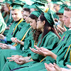 SHEILA SELMAN | THE GOSHEN NEWS<br /> Concord graduates look at their hands as instructed by art teacher Bob Bieber, who was the speaker for commencement Thursday night.