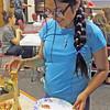 Liz Rieth | The Goshen News<br /> Melissa Ortega, 12, picks up her next piece of pizza at GPL Teens PizzaFest Thursday.