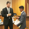 JOHN KLINE | THE GOSHEN NEWS<br /> Recent Goshen High School graduate Jason Barahona, right, accepts a plaque from Goshen Mayor Jeremy Stutsman commemorating his time as the 2017-18 youth adviser to the Goshen City Council during the council's meeting Tuesday evening.