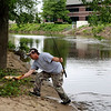 AIMEE AMBROSE | THE GOSHEN NEWS <br /> <br /> Allen Welburn, Three Rivers, Michigan, scoops up a 21.5 inch carp he caught in the Elkhart River near Island Park during the annual Elkhart Family Fish Fest Saturday.