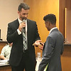 JOHN KLINE | THE GOSHEN NEWS<br /> Recent Goshen High School graduate Jason Barahona, right, accepts a ceremonial key to the city from Goshen Mayor Jeremy Stutsman in recognition of his service as the 2017-18 youth adviser to the Goshen City Council during the council's meeting Tuesday evening.