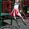 SHEILA SELMAN | THE GOSHEN NEWS<br /> Caroline Looney, 10, Goshen, swings from the monkey bars at Sunnyside Park in New Paris Monday afternoon.