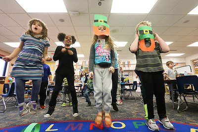 "LEANDRA BEABOUT | THE GOSHEN NEWS Kindergarten students in Carrie Garber's class jump and sing along to ""Dance Dance Leprechaun Dance"" by the Kiboomers."