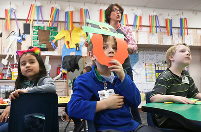 LEANDRA BEABOUT | THE GOSHEN NEWS Kindergartener Henry Jeeves, center, watches traditional Irish dancing while his teacher, Carrie Garber, explains a few Irish traditions to the class.