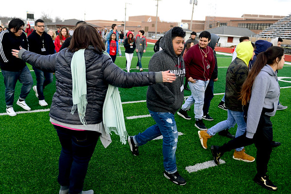 BEN MIKESELL | THE GOSHEN NEWS<br /> Goshen High School students walk onto on Foreman Field Wednesday morning to participate in the national walkout planned across the country to honor the victims of last month's school shooting in Parkland, Florida.
