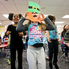 LEANDRA BEABOUT | THE GOSHEN NEWS<br /> Kindergartener Izabella Wingard dances to Irish music with her leprechaun mask on in Carrie Garber's classroom at West Goshen Elementary. For more photos of the class's activities, see C1.