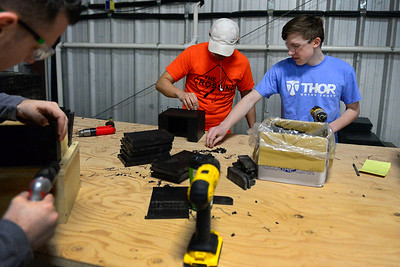 BEN MIKESELL | THE GOSHEN NEWS Ryan Rosansky, 17, right, works with Logan Rumbaugh, 16, to make cupholders Tuesday at Thor Motor Coach in Wakarusa. The two are enrolled in the Crossing School of Business & Entrepreneurship, and spend one half of the day learning curriculum, and the other half assembling parts for Thor to be used in their vehicles.