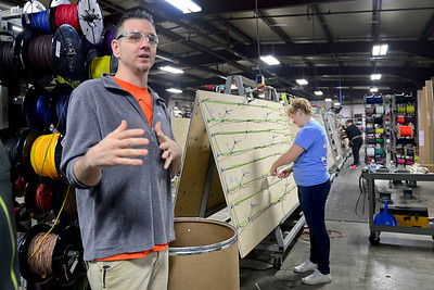 BEN MIKESELL | THE GOSHEN NEWS Shannon Cooper, the Job Training Instructor for the Crossing School of Business & Entrepreneurship, gives a walkthrough of student involvement Tuesday at Thor Motor Coach's Wakarusa-based factory.