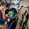 BEN MIKESELL | THE GOSHEN NEWS<br /> Sixteen-year-old Ben Ruttschaw of Goshen, left, works with his mentor, Charles Steele, to learn how to run cables Tuesday at Thor Motor Coach in Wakarusa. Ruttschaw is enrolled in the Crossing School of Business & Entrepreneurship and spends half the day learning cirriculum and the other half making parts for Thor's vehicles.