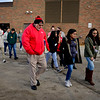 BEN MIKESELL | THE GOSHEN NEWS<br /> Goshen High School principal Barry Younghans walks with students Wednesday morning as they gather on the field to show solidarity for the victims of last month's school shooting in Parkland, Fla., which prompted a national walkout to be organized. While the administration did not want to take a stance politically on the gun control debate, they allowed the students to exercise their first amendment rights by honoring the victims of the shooting.