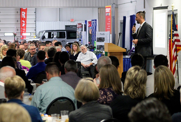 Roger Schneider | The Goshen News<br /> Former Goshen High School biology teacher Carl Weaver, center, is sits in the crowd and listens as Mayor Jeremy Stutsman gives his state of the city address Thursday.