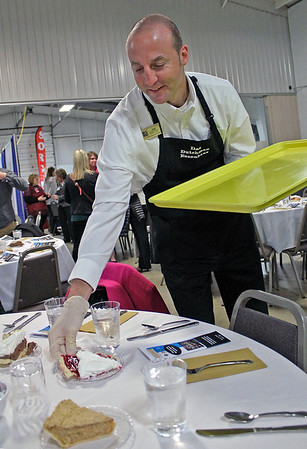 Roger Schneider | The Goshen News<br /> Joel Miller of Das Dutchman Essenhaus sets out a slice of raspberry cream pie before the start of the Goshen Founder's Day event Thursday. Miller said the pie flavor is the favorite with the company's customers.