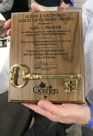 Roger Schneider | The Goshen News<br /> Carl Weaver holds his Good of Goshen award he received at the Goshen Founders Day luncheon Thursday.