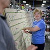BEN MIKESELL | THE GOSHEN NEWS<br /> Seventeen-year-old Summer Scheetz, a junior in the Crossing School of Business & Entrepreneurship, works on wiring at Thor Motor Coach's Wakarusa-based factory. Through a partnership with the Crossing, Thor, and the Teachers Credit Union, students receive hands-on experience working on an assembly line while going to school.