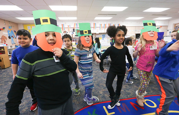 LEANDRA BEABOUT | THE GOSHEN NEWS Students at West Goshen Elementary School dance an Irish jig in Carrie Garber's kindergarten class.