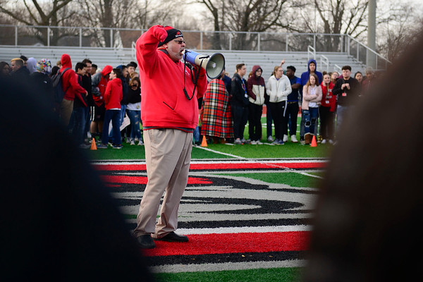BEN MIKESELL | THE GOSHEN NEWS<br /> Goshen High School principal Barry Younghans directs students Wednesday morning as they gather on the field to show solidarity for the victims of last month's school shooting in Parkland, Fla., which prompted a national walkout to be organized. While the administration did not want to take a stance politically on the gun control debate, they allowed the students to exercise their first amendment rights by honoring the victims of the shooting.