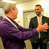 Roger Schneider | The Goshen News<br /> <br /> Shan Hartsough, corporate account manager at Mapletronics, left, shares a story with Goshen Mayor Jeremey Stutsman during the Goshen Founder's Day event Thursday. Stutsman later gave his state of the city address to a crowd of 390 people.