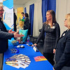 Roger Schneider | The Goshen News<br /> Keith Sarber of the United Way chats with Megan Pletcher, center, and Lisa Zollinger at the Waterford Commons booth at the Goshen Founder's Day event Thursday.