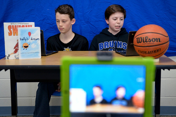 BEN MIKESELL | THE GOSHEN NEWS<br /> Bethany Christian sixth-graders Tyson Chupp, left, and Tristan Mast list off the top NCAA Tournament upsets while making a basketball telecast Wednesday as part of Bethany Christian's week-long Interterm week. The middle schoolers in Matt Miller's March Madness themed class spent the week learning about college basketball and making sports talk shows.