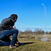 BEN MIKESELL | THE GOSHEN NEWS<br /> Bethany Christian sophomore Jacob Woolace fires his rocket into the sky Friday during Bethany Christian's week-long Interterm program.