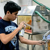 BEN MIKESELL | THE GOSHEN NEWS<br /> Bethany Christian sophomore Sam Ostergren spray paints the nose of his rocket Wednesday during Calvin Swartzendruber's Airplanes, Model Rockets and Drones class for Interterm week. Ostergren's group spent the week learning learning about avionics and how to fly the school's DJI Phantom 4 Pro drone.