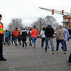"BEN MIKESELL | THE GOSHEN NEWS<br /> Goshen Police officer Alex Rosales stops traffic for protesters to cross Lincoln Avenue Saturday during the March for Our Lives protest. Many thanked Rosales as they walked by. ""I wasn't expecting so many to thank me, especially with so much going on,"" Rosales said."