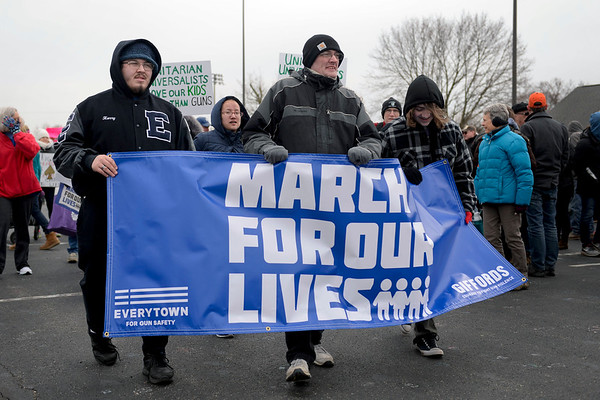 BEN MIKESELL | THE GOSHEN NEWS<br /> The March for Our Lives protesters begin walking from Goshen High School on their way to the Courthouse Saturday, calling for gun legislation to improve safety in schools.