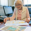 Roger Schneider | The Goshen News<br /> Ligonier Mayor Patty Fisel looks at maps in her City Hall office that show a newly-annexed area and city projects that are either planned or underway.
