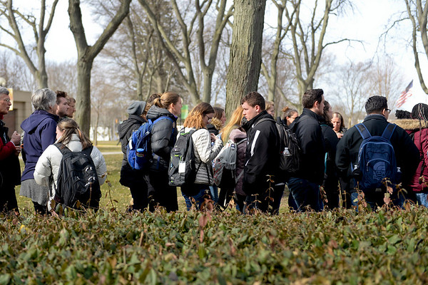 BEN MIKESELL | THE GOSHEN NEWS<br /> Goshen College students and faculty participate in a walkout Wednesday to protest racism on campus. A proposal for anti-racism training for professors and student leaders was presented to President Rebecca Stoltzfus.
