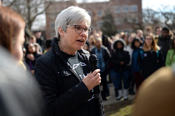 BEN MIKESELL | THE GOSHEN NEWS<br /> Goshen College president Rebecca Stoltzfus speaks to the crowd gathered outside the Administration Building during a walkout Wednesday organized by the Intercultural Coalition of Goshen College to address concerns about racism on campus. Stoltzfus said she is eager and willing to work with the students to address policy changes.