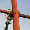 ROGER SCHNEIDER | THE GOSHEN NEWS<br /> A worker with PAR Electrical Contractors Inc. of Kansas City, Missouri, works in a bucket at the top of a crane to install equipment on a  new electric transmission tower at C.R. 29 and U.S. 6 Monday. The tower is one of many that make up the new100-mile  NIPSCO transmission line from Reynolds and Burr Oak to Topeka. The project is expected to be completed late this year, according to NIPSCO's website.