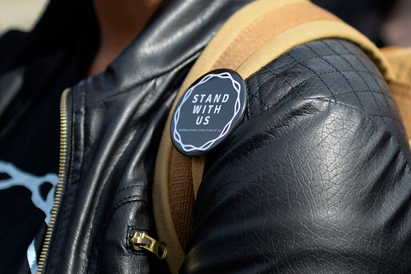 BEN MIKESELL | THE GOSHEN NEWS<br /> Pins were given to Goshen College students as they participated in Wednesday's walkout to address concerns about racism on campus.