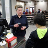 GEOFF LESAR | THE GOSHEN NEWS<br /> <br /> Pianist Anne Gaines scans ID cards during lunchtime while working her day job at Goshen Middle School Wednesday afternoon.