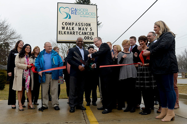 BEN MIKESELL | THE GOSHEN NEWS<br /> Executive director Peter Norton cuts the ribbon to announce United Cancer Services of Elkhart County's official name change Tuesday to Cancer Resources for Elkhart County.