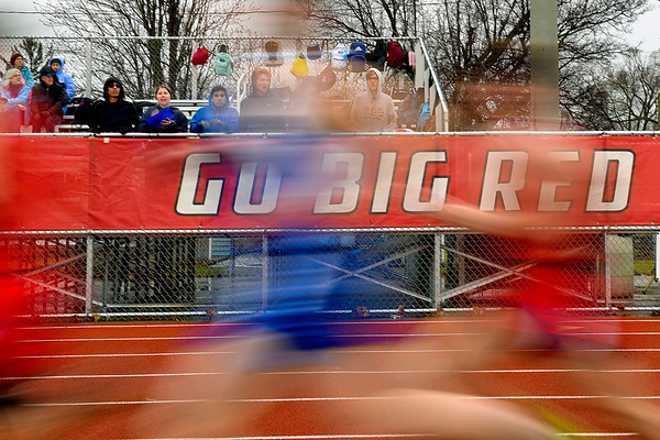 BEN MIKESELL | THE GOSHEN NEWS<br /> Runners from Lakeland, West Noble, and Bethany Christian compete in the 4x800 race Tuesday at host Goshen High School, the first home meet of the season for the Red Hawks.