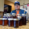 BEN MIKESELL | THE GOSHEN NEWS<br /> Glenn Stutzman shows off his maple syrup yield Monday in the kitchen of his home on Apple Lane in Goshen. Stutzman predicts that he will have made four gallons of syrup by Wednesday using his setup in his backyard.