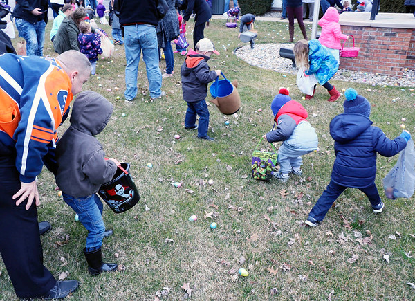 JOHN KLINE | THE GOSHEN NEWS<br /> Excited kids with Easter baskets in hand swarm the grounds of Memorial Park in downtown Middlebury Saturday morning during the annual Middlebury Township Fire Department Easter Egg Hunt.