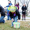 JOHN KLINE | THE GOSHEN NEWS<br /> Ethan Sparrow, 4, of Middlebury, uses his monster hat to scare off the competition while collecting candy-filled Easter eggs during the annual Middlebury Township Fire Department Easter Egg Hunt at Memorial Park in downtown Middlebury Saturday morning.