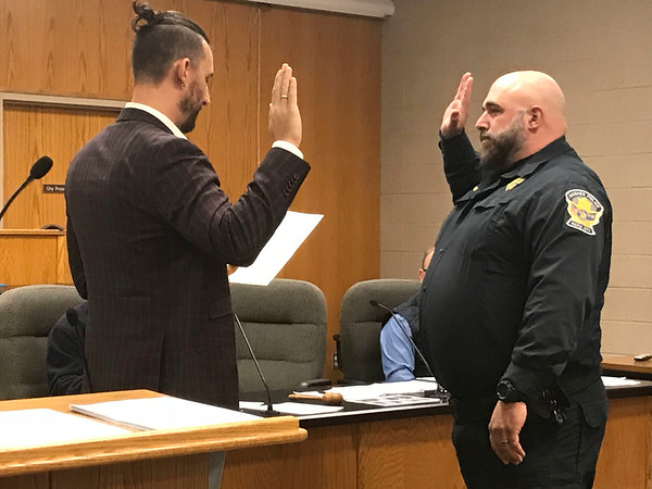 JOHN KLINE | THE GOSHEN NEWS<br /> Joshua M. Havens, right, is promoted to the rank of detective with the Goshen Police Department by Mayor Jeremy Stutsman during the Board of Public Works and Safety meeting Monday afternoon.