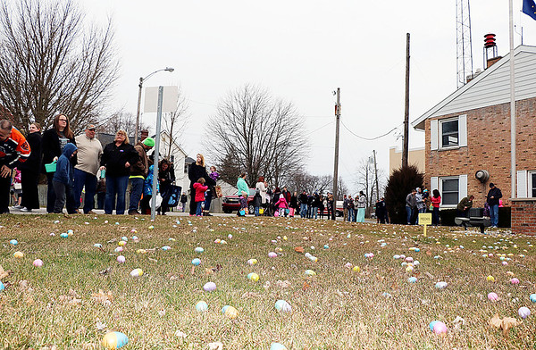 JOHN KLINE | THE GOSHEN NEWS<br /> Attendees of the annual Middlebury Township Fire Department Easter Egg Hunt gather on the grounds of Memorial Park in downtown Middlebury Saturday morning.