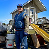 BEN MIKESELL | THE GOSHEN NEWS<br /> Glenn Stutzman stands near his maple syrup station Monday in the backyard of his home on Apple Lane in Goshen. Stutzman turned the playground into a makeshift syrup maker, allowing the sap to drip into the tank below.