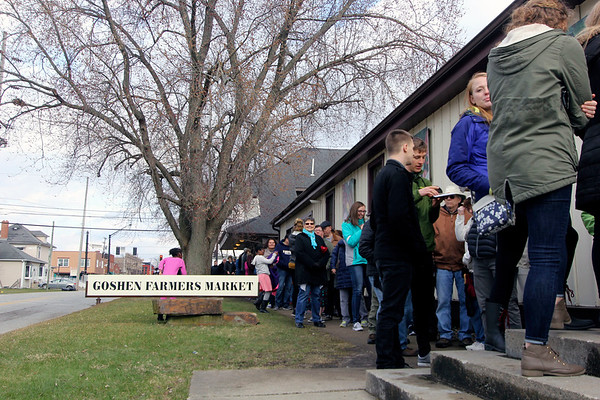 GEOFF LESAR | THE GOSHEN NEWS<br /> <br /> A queue stretches along Washington Street outside the Goshen Farmers Market Saturday evening for the 18th annual Empty Bowl Soup Supper.