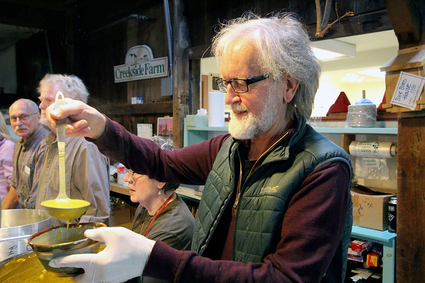 GEOFF LESAR | THE GOSHEN NEWS<br /> <br /> Jerry Lapp, Goshen, a member of Goshen Clay Artists Guild, ladles a portion of his butternut squash bisque for an attendee of the 18th annual Empty Bowl Soup Supper.