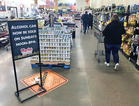 JOHN KLINE | THE GOSHEN NEWS<br /> A sign informing customers that Sunday alcohol sales are now legal in the state of Indiana can be seen in the entryway of the Martin's Super Market in Goshen Sunday afternoon.