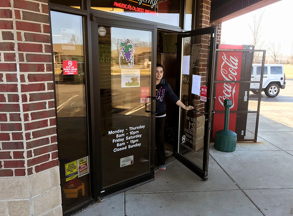 JOHN KLINE | THE GOSHEN NEWS<br /> Andrayanna Bird, assistant manager of the Chalet Party Shoppe on C.R. 17 in Elkhart, opens the doors to the store at noon Sunday.